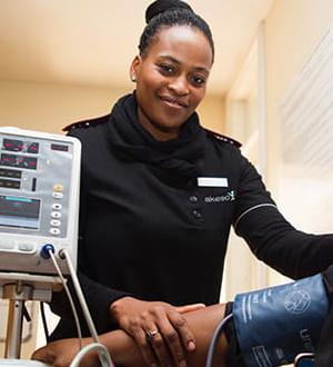 A nurse taking someone's blood pressure