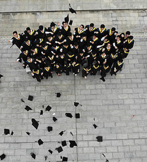 Graduates throwing their graduation caps in the air