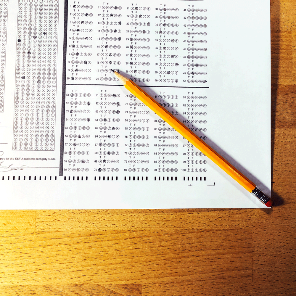 A pencil on top of a scantron